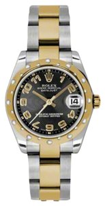Rolex Rolex New Style Pre Owned Datejust Steel and Yellow Gold Black Concentric Arabic Dial 31mm