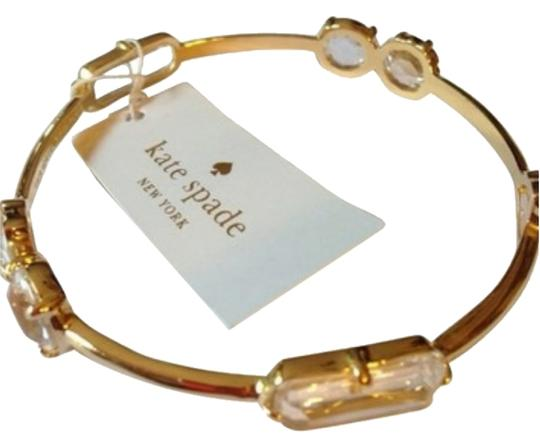 Preload https://item5.tradesy.com/images/kate-spade-gold-and-clear-new-york-bangle-bracelet-1765284-0-0.jpg?width=440&height=440