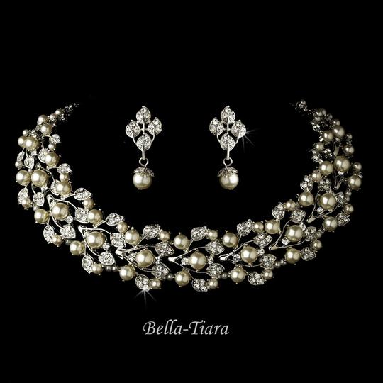 Preload https://item5.tradesy.com/images/bellatiara-silver-white-necklace-and-earring-set-wholesale-1766259-0-0.jpg?width=440&height=440