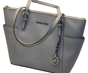 29f45098dee9 Added to Shopping Bag. Michael Kors Jet Set Top Zip Tote in Pearl Gray
