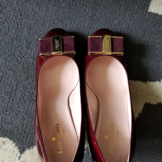 Preload https://item2.tradesy.com/images/kate-spade-ruby-bordeaux-red-malta-heeled-pumps-70-17669791-0-1.jpg?width=440&height=440
