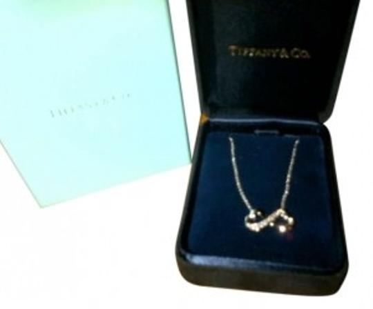 Preload https://item1.tradesy.com/images/tiffany-and-co-sterling-silver-with-diamond-chips-infinity-necklace-176710-0-0.jpg?width=440&height=440