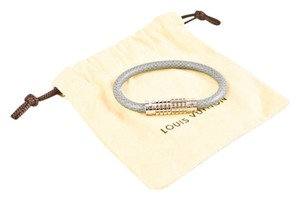 Louis Vuitton Authentic NEW Louis Vuitton Grey Taiga Leather Digit Bracelet Sz 19