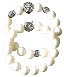 Marta's Designs Marta's Designs Set of 2 Angel Skin Coral Stretch Bracelets - Lion and Owl Center Beads