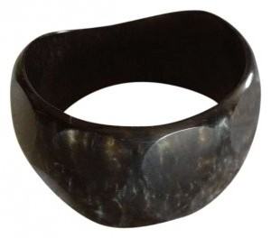 Unknown Black bangle with gold undertones