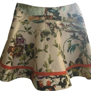 Ted Baker Skirt Floral with red ribbon near hem.