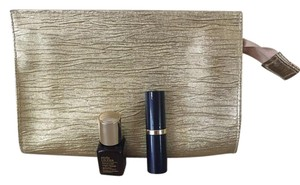 Estée Lauder Gold cosmetic bag and lipstick and serum