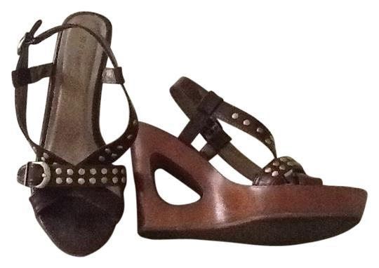 Preload https://item2.tradesy.com/images/madden-girl-brown-wedges-size-us-75-regular-m-b-177406-0-0.jpg?width=440&height=440
