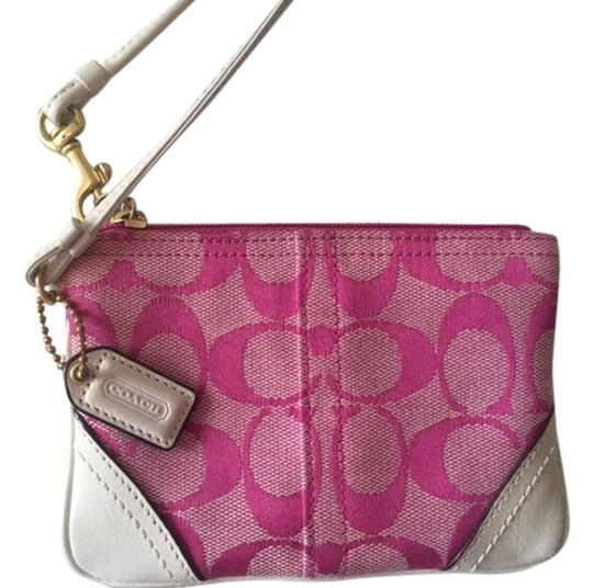 Preload https://item2.tradesy.com/images/coach-signature-small-pink-wristlet-1776301-0-0.jpg?width=440&height=440