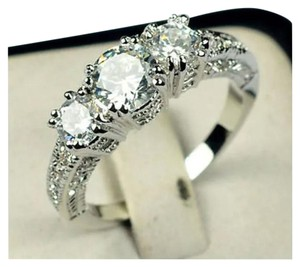 Past/Present/Future antique style tri stone AAA CZ wedding ring