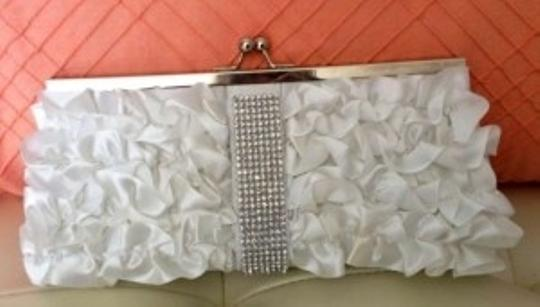 Preload https://item2.tradesy.com/images/white-satin-with-rhinestone-strip-clutch-bridal-handbag-177686-0-0.jpg?width=440&height=440