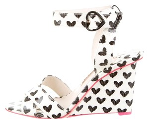 Sophia Webster Amanda Heart Patent Leather White Wedges
