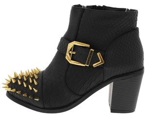 Black, gold Boots