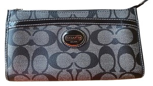 Coach This wallet has TONS of pockets and light weight!