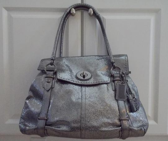 Preload https://item3.tradesy.com/images/coach-large-sydney-flagship-metallic-gunmetal-crackle-leather-shoulder-bag-1779237-0-0.jpg?width=440&height=440
