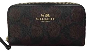 NWT coach coin wallet, brand new! Brand new coach coin wallet with tag. Leather Trim Double Zip Closure Fabric Lining Zip Coin Pockets & Credit Card Pockets on both sides 4.5