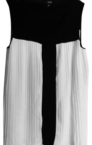 a.n.a. a new approach Top Black/white