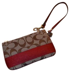 Coach Canvas Leather Logo Wristlet in Brown/Cranberry