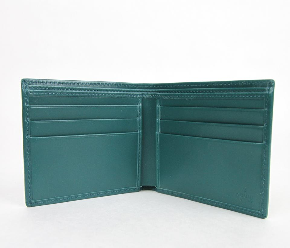5cb978779e9a Gucci New Gucci Men's Teal Imprime Leather Bifold Wallet 145754 4715 Image  3. 1234