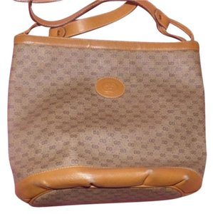 Gucci High-end Bohemian Shoulder/Cross Body Great Everyday Bucket Style Multiple Compartment Satchel in coated canvas with small G print & leather in browns