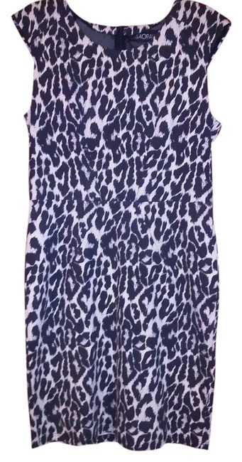 Preload https://img-static.tradesy.com/item/17818927/blackbeige-animal-print-form-fitting-knee-length-workoffice-dress-size-8-m-0-1-650-650.jpg