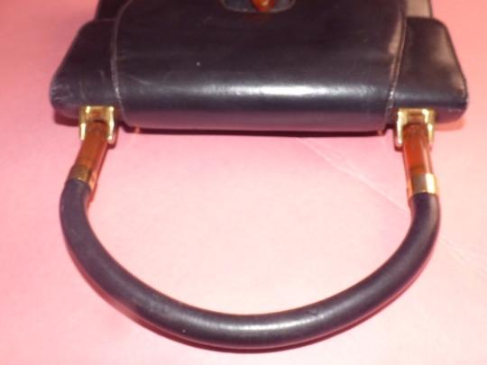 Gucci Early Mod Kelly Style Multiple Compartment Lucite/Gold Accordion Bottom Satchel in black with tortoise shell Lucite and gold accents