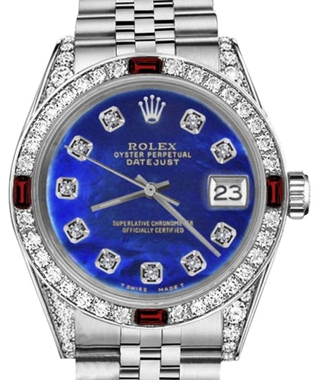 Preload https://img-static.tradesy.com/item/17821477/rolex-ladies-26mm-datejust-blue-treated-mop-dial-with-ruby-and-diamond-watch-0-1-540-540.jpg