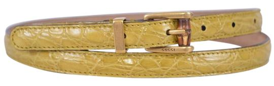 Preload https://img-static.tradesy.com/item/17830354/gucci-yellow-alligator-embossed-leather-skinny-belt-0-1-540-540.jpg