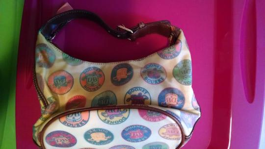 Dooney & Bourke Satchel in multi color on cream background