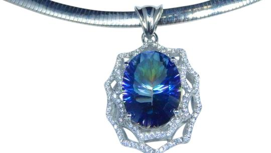 Preload https://img-static.tradesy.com/item/17835313/925-mystic-blue-sterling-silver-dazzling-oval-shape-starburst-cut-quartz-pendant-necklace-0-1-540-540.jpg