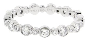 Tiffany & Co. Tiffany & CO bezel set round diamond Jazz has rhythm eternity band in