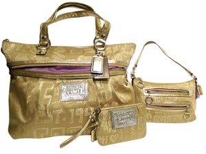 Coach Poppy Storypatch Large Tote in Gold with Silver Tone Hardware. Purple Sateen Lining