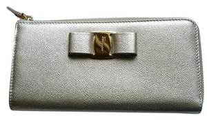 Salvatore Ferragamo *New with tags* Miss Vara Bow Zip Continental Wallet in Metallic Gold