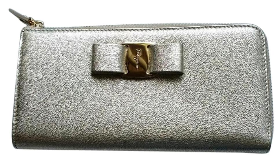 Salvatore Ferragamo  New with tags  Miss Vara Bow Zip Continental Wallet in  Metallic Gold ... 585c1a960c