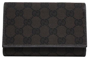 Gucci Gucci GG Canvas and Leather Women's Trifold Wallet 263114
