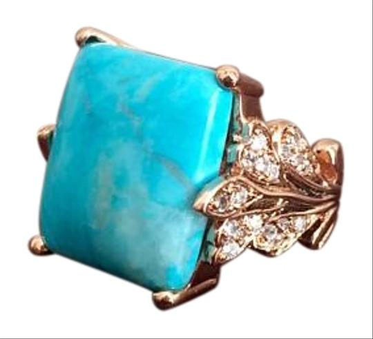 Preload https://img-static.tradesy.com/item/1786583/turquoise-and-gold-ring-0-3-540-540.jpg