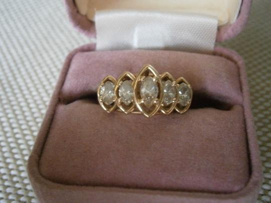 Other Solid 14k gold with over 1 1/2 carats of diamonds.