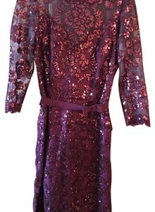 Tadashi Shoji Burgundy Embroidered Lace (photos from Bloomie's website show style/length/details and current pricing- not the same color) Dress