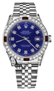 Rolex Womens Rolex 31mm Datejust Blue Dial with Ruby & Diamonds BezelAccent