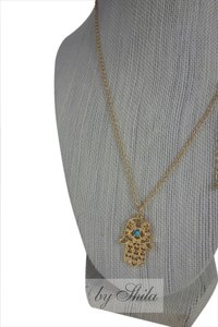 Shiekh Hamsa necklace with turquoise stone in the middle