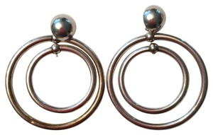 Other Sterling silver pierced circle within circle swivel dangle earrings