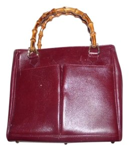 Gucci Restored Lining Bamboo Handles Equestrian Accents Tote/Satchel Style Exterior Pockets Satchel in burgundy leather