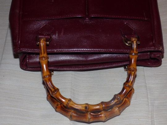 Gucci Restored Lining Bamboo Handles Equestrian Accents Tote/Satchel Style Exterior Pockets Satchel in burgundy leather Image 1