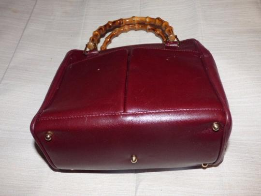 Gucci Restored Lining Bamboo Handles Equestrian Accents Tote/Satchel Style Exterior Pockets Satchel in burgundy leather Image 2