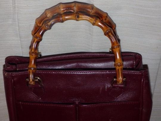 Gucci Restored Lining Bamboo Handles Equestrian Accents Tote/Satchel Style Exterior Pockets Satchel in burgundy leather Image 5