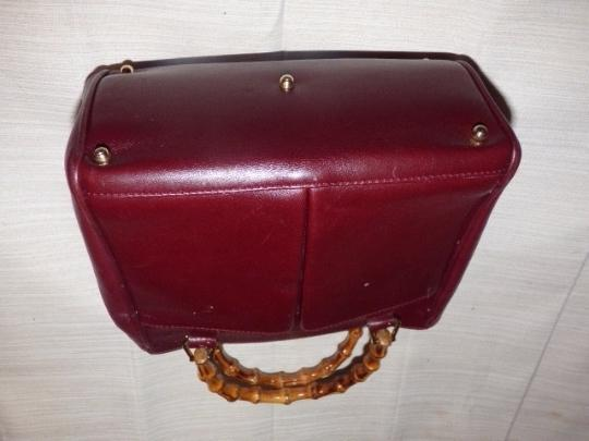 Gucci Restored Lining Bamboo Handles Equestrian Accents Tote/Satchel Style Exterior Pockets Satchel in burgundy leather Image 6