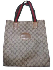 Gucci Smaller Style Interior Pockets Tote in leather & large G logo print coated canvas in shades of brown with red/green striped handles