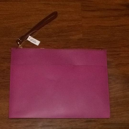 Preload https://item1.tradesy.com/images/kate-spade-wrist-pouch-magenta-polyester-clutch-1798995-0-0.jpg?width=440&height=440