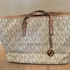 Michael Kors Jet Multifunction Logo Travel Saffiano Leather Tote in Vanilla