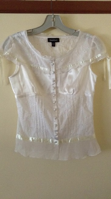 Preload https://item1.tradesy.com/images/bebe-white-button-down-top-size-2-xs-180045-0-0.jpg?width=400&height=650